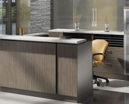 Global Zira desk in a reception area setting.